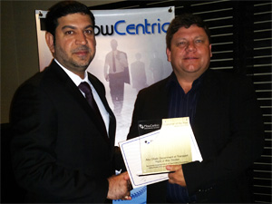 Waleed Abdulla  Al Hayyas accepting FlowCentric Middle East Customer of the Year 2012  award from Jacques Wessels.