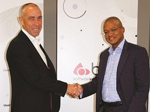 BBD CEO Peter Searle and Sphere CEO Itumeleng Kgaboesele shake on the deal that makes BBD 51% black-owned.