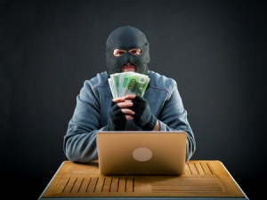 Cyber criminals hold local companies 'hostage'.