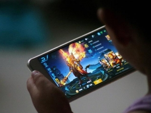 A child plays the Tencent game Honour of Kings.