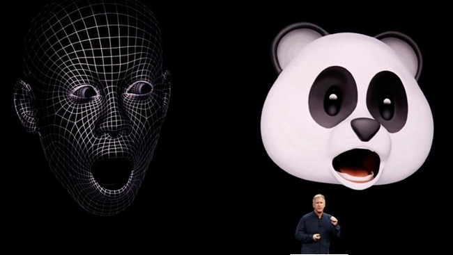Apple senior VP of worldwide marketing Phil Schiller shows animoji during a launch event.