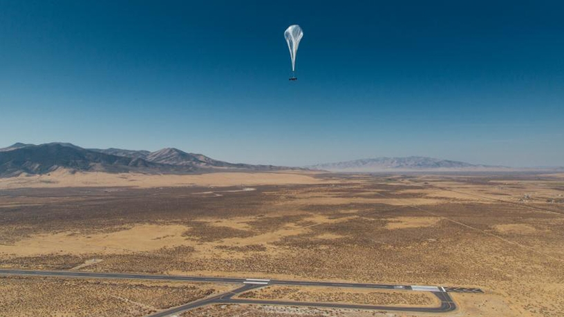 A Project Loon balloon flying high.
