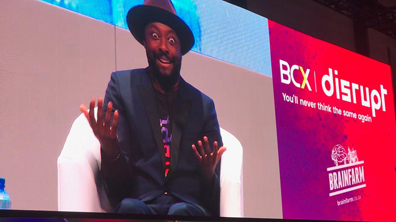 Will.i.am onstage at the BCX Disrupt Summit.